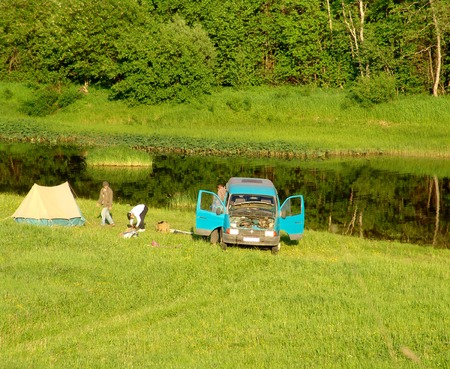 A team of camping people preparing for depart photo