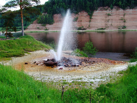 A natural fountain powered by underground forces photo