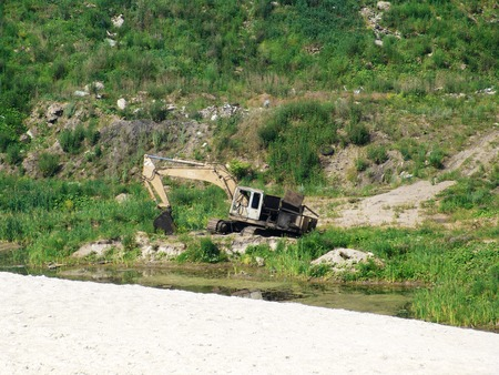 sand quarry: An old weathered dredger forgotten near a sand quarry