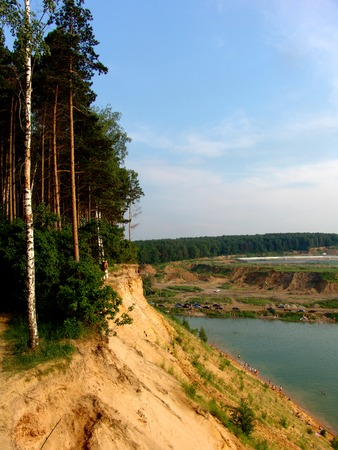 the silence of the world: Yellow sand cliffs with trees on top Stock Photo