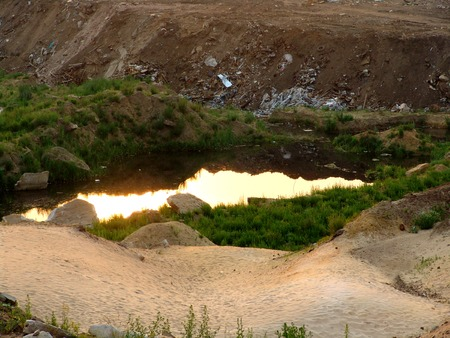A dangerous toxic pond near a city waste landfill photo