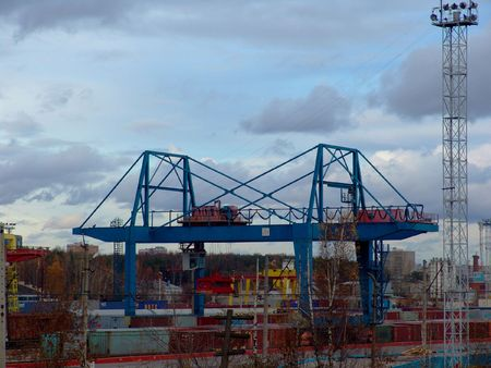 deliverables: A crane used for loading and unloading containers to a freighter train