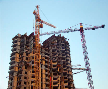 construction company: A high building under construction half built Stock Photo