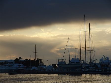 fishnets: A view of a yachts and boats harbor in the evening Stock Photo