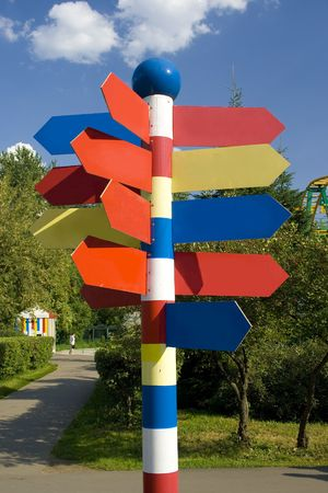 A pylone with empty direction marks in a theme park photo