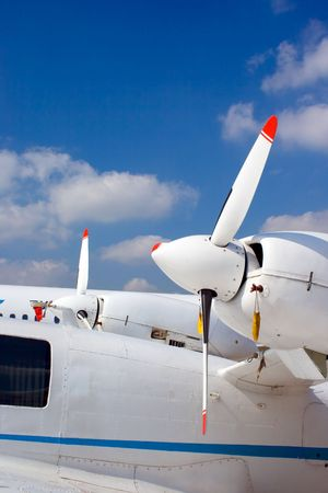 Side engines of a small white business plane photo