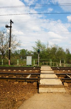 wood railroads: A railroad pedestrian crossing with light signals Stock Photo