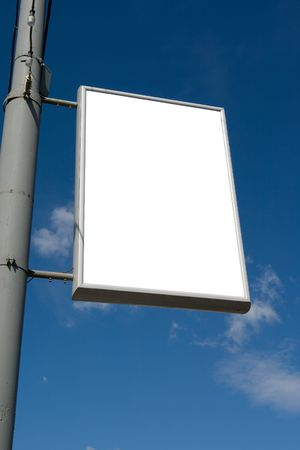 advertisment: An advertisment panel fixed on a lights pole over a blue sky Stock Photo