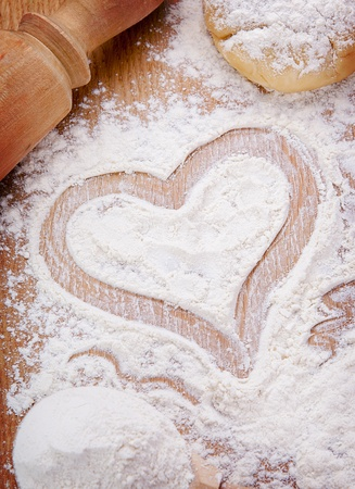 Elegant Heart Drawn With Flour On The Kitchen Table. Food Ingredient Photo