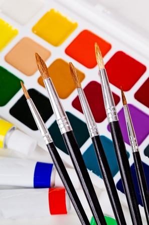 A set of brushes on the background of acrylic and watercolor Stock Photo - 20690004