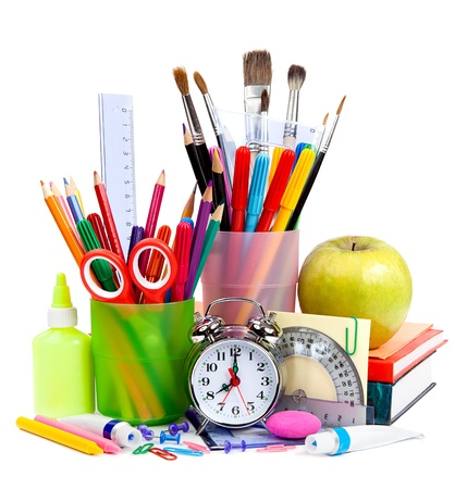 Back to School. Pencils and pens in cups on the table Stock Photo