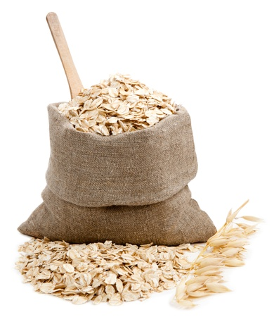 Rolled oats in a bag isolated on white background Stock Photo