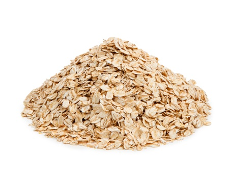 Oat flakes isolated on white background. Healthy eating photo