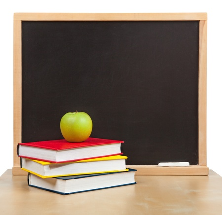 Back to school. School board and books and apple isolated photo