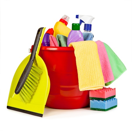 Nice arrangement of items for cleaning. Bucket, brush and shovel, spray bottles of chemicals isolated on white background