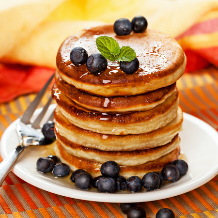 Fresh pancakes with blueberries and honey photo