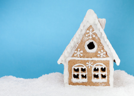 gingerbread house: Homemade gingerbread house on blue background
