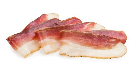 cured ham: Slices of tasty spanish ham on white background