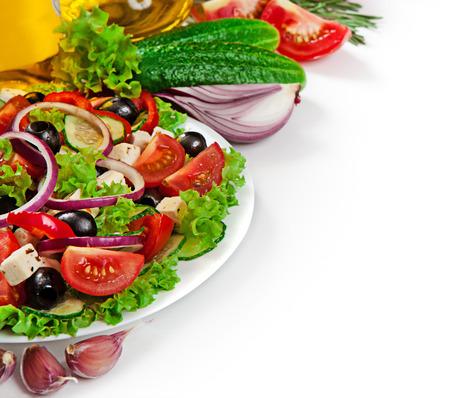 greek cuisine: Greek cuisine - fresh vegetable salad isolated on white background Stock Photo