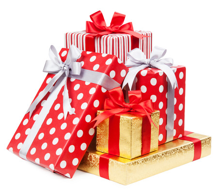 Red and striped and gold boxes with gifts tied bows on white background