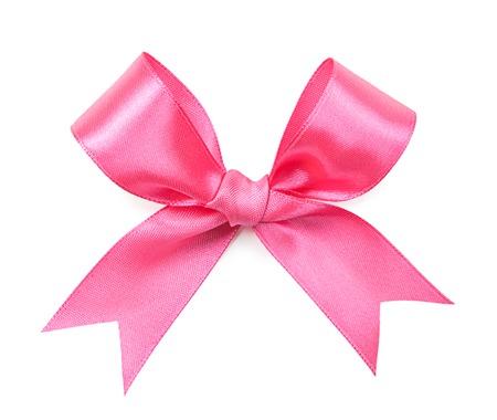 moño rosa: lazo rosa de color aislado en el fondo blanco Foto de archivo