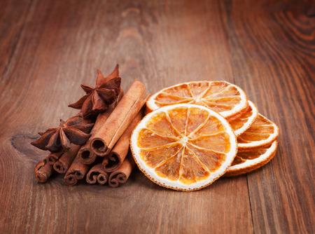 dried orange: Christmas decoration - dried orange, cinnamon sticks, cloves on the table