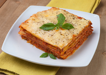 flavorful: Tasty flavorful lasagna on a plate and ingredients