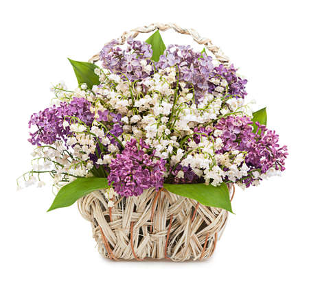 the valleys: Spring bouquet. Lily of the valley and lilac in a basket isolated