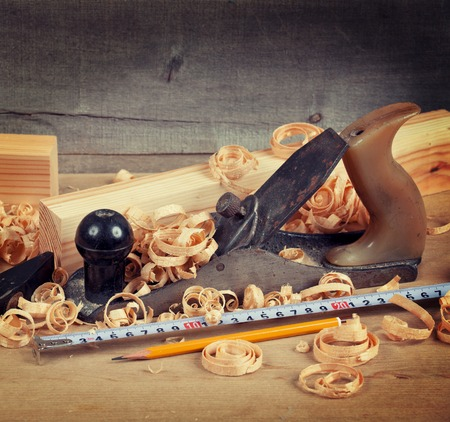wood planer: Wood planer, shavings and hand tools on board Stock Photo