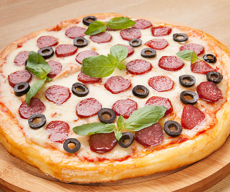 flavorful: Fresh flavorful pepperoni pizza on wood