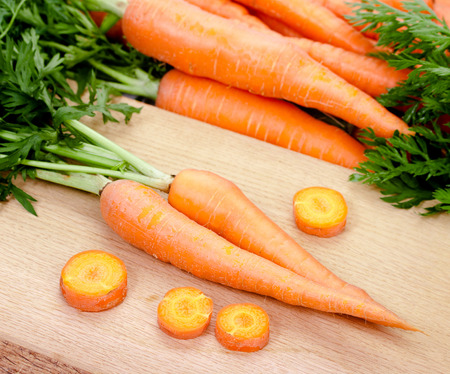 dominant color: Carrots isolated on white background