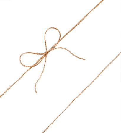 gefesselt: String and bow isolated on white background. Lizenzfreie Bilder