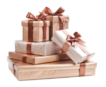 boxes with gifts and brown bows isolated on white background Stock Photo