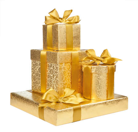 presents: Boxes of gold wrapping paper isolated on white background