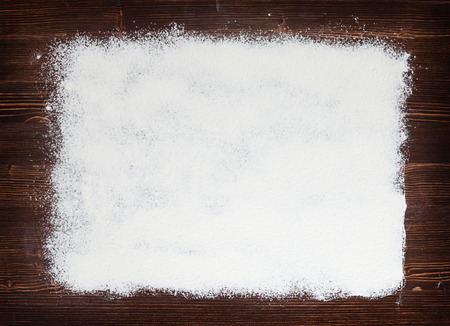 kitchen background: abstract flour sprinkled on the old board Stock Photo