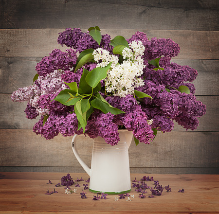 fragrant: The beautiful lilac on a wooden background