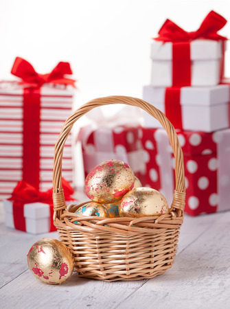 aureate: Gold easter eggs in basket on board