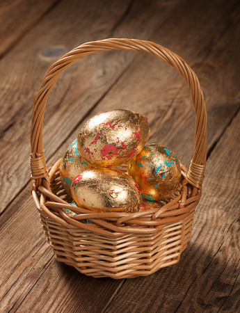 div: Easter golden eggs in a basket on table. div concept Stock Photo