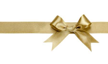 cintas  navide�as: Cinta de oro con el arco aislado en fondo blanco Foto de archivo