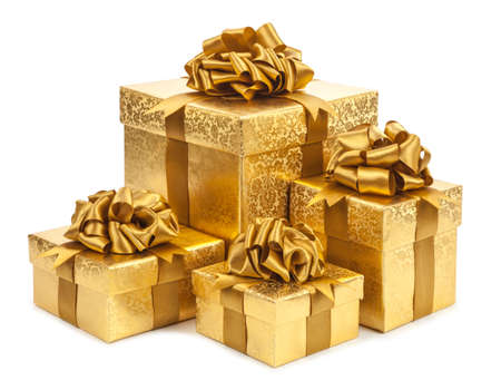 presents: Gift boxes of gold color isolated on white background. Stock Photo