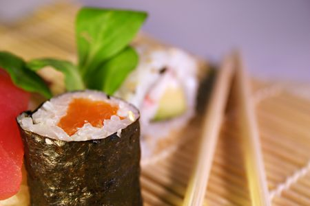 entrees: Maki with blurred chopsticks Stock Photo