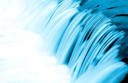 blue toned: Small waterfall, blue toned, long exposure Stock Photo