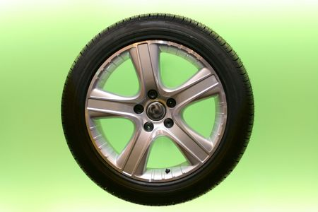 pneumatic tyres: Car rim and tire on semi-transparent green background