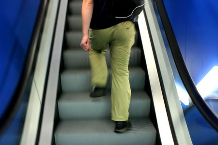 Motion photo of man on escalator photo