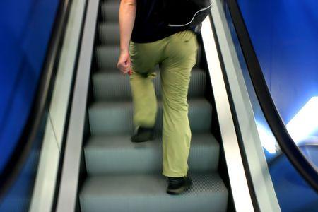 Motion photo of man on escalator photo
