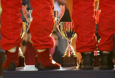 anthem:  Winning rally team on podium with trophies