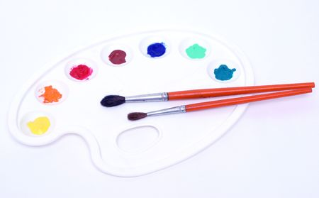 Painters palette and paintbrushes photo