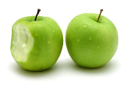 bitten: Two green apples on white background