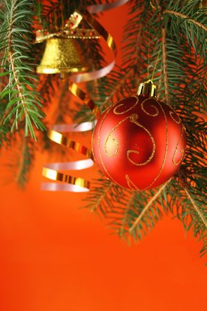 handbell: Christmas background with a bauble and a handbell