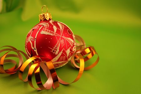 Christmas bauble on a green background Stock Photo - 666255